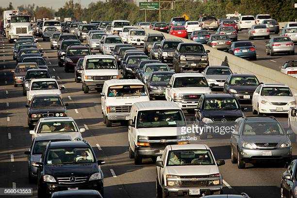 Vehicles crowd the 101 Ventura Freeway during morning rush hour in Encino just west of the 101 and 405 San Diego Freeway interchange on Wednesday as...
