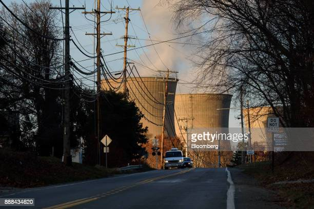 Vehicles drive along a road near the FirstEnergy Corp Bruce Mansfield coalfired power plant in Shippingport Pennsylvania US on Sunday Dec 3 2017...