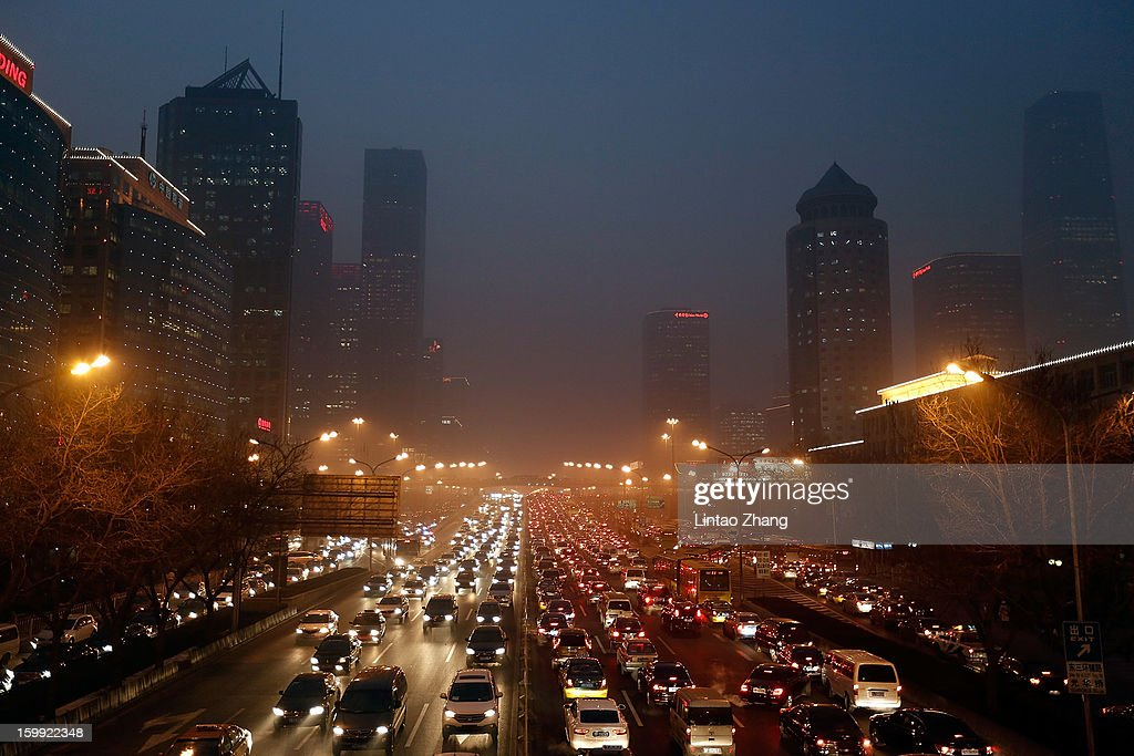 Vehicles drive at the CBD business district during severe pollution on January 23, 2013 in Beijing, China. The air quality in Beijing on Wednesday hit serious levels again as smog blanketed the city.