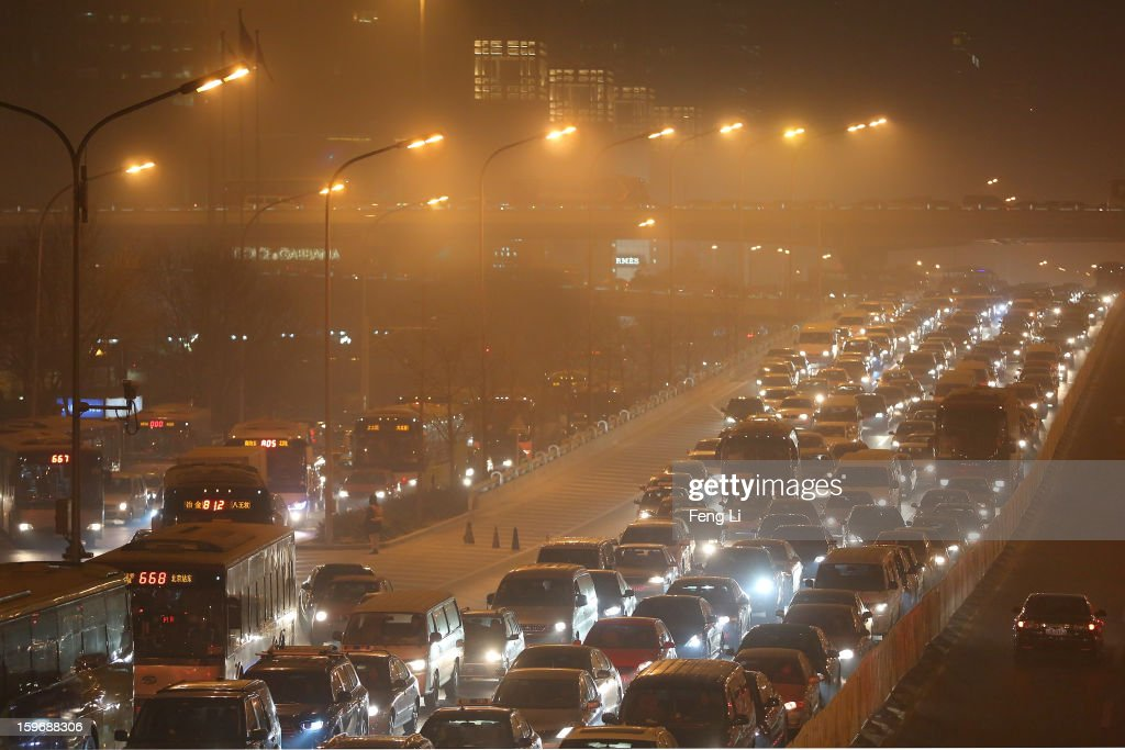 Vehicles drive at the central business district during severe pollution on January 18, 2013 in Beijing, China.