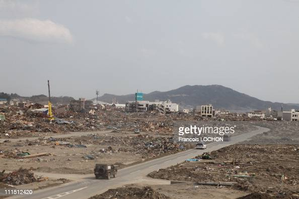 Vehicles drive down a street April 2 2011in Rikusen Takata City Japan The 90 magnitude strong earthquake struck offshore on March 11 at 246pm local...