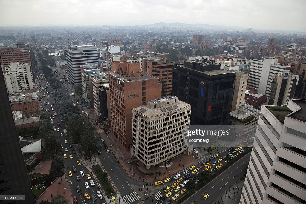 Vehicles drive down the street in the financial district of Bogota, Colombia, on Friday, March 22, 2013. Central bank policy makers will lower borrowing costs by 25 basis points to 3.5 percent on March 22, according to 29 of 32 analysts and economists surveyed by Bloomberg. Photographer: Jose Cendon/Bloomberg via Getty Images