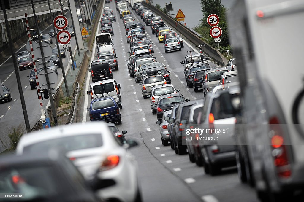 Vehicles drive in traffic jams on the A7 motorway on July, 23, 2011 near Vienne, southeastern France. 400 km-long-traffic jams were reported at midday in France, among them 140 km in Rhone-Alpes region, on the way to the French Riviera and Italy.
