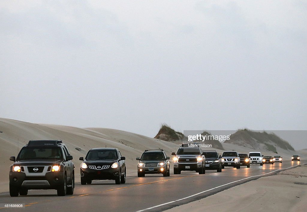 Vehicles drive north on Hwy 12 due to mandatory evacuation for Hatteras Island due to approaching Tropical Storm Arthur, July 3, 2014 in Pea Island, North Carolina. A Hurricane warning has been issued for North Carolina's Outer Banks due to approaching Tropical Storm Arthur that is expected to gain strength and become a catagory 1 hurricane when it passes the area.