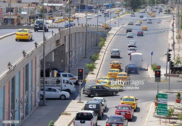 Vehicles drive on a road in Iraq's ethnically mixed oil city of Kirkuk on June 19 2014 Iraqi Prime Minister Nuri alMaliki today ordered back to duty...