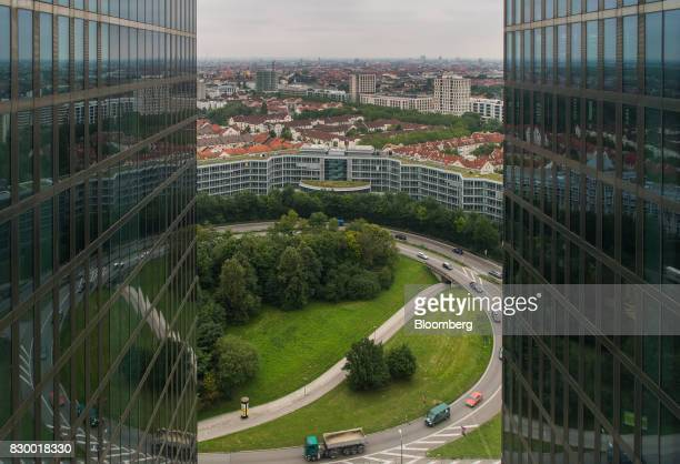 Vehicles drive on a roundabout as seen from the 20th floor of the International Business Machines Corp Watson cognitive computing platform Internet...