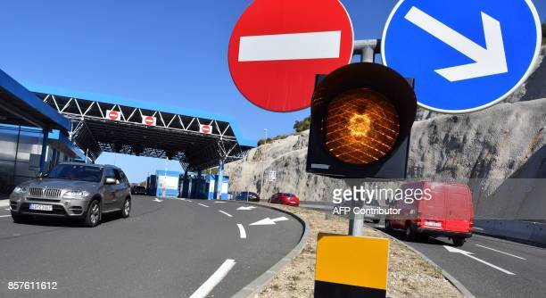 Vehicles drive on September 25 towards the border between Bosnia and Croatia located in the village of Zaton Doli along Croatia's main Adriatic route...
