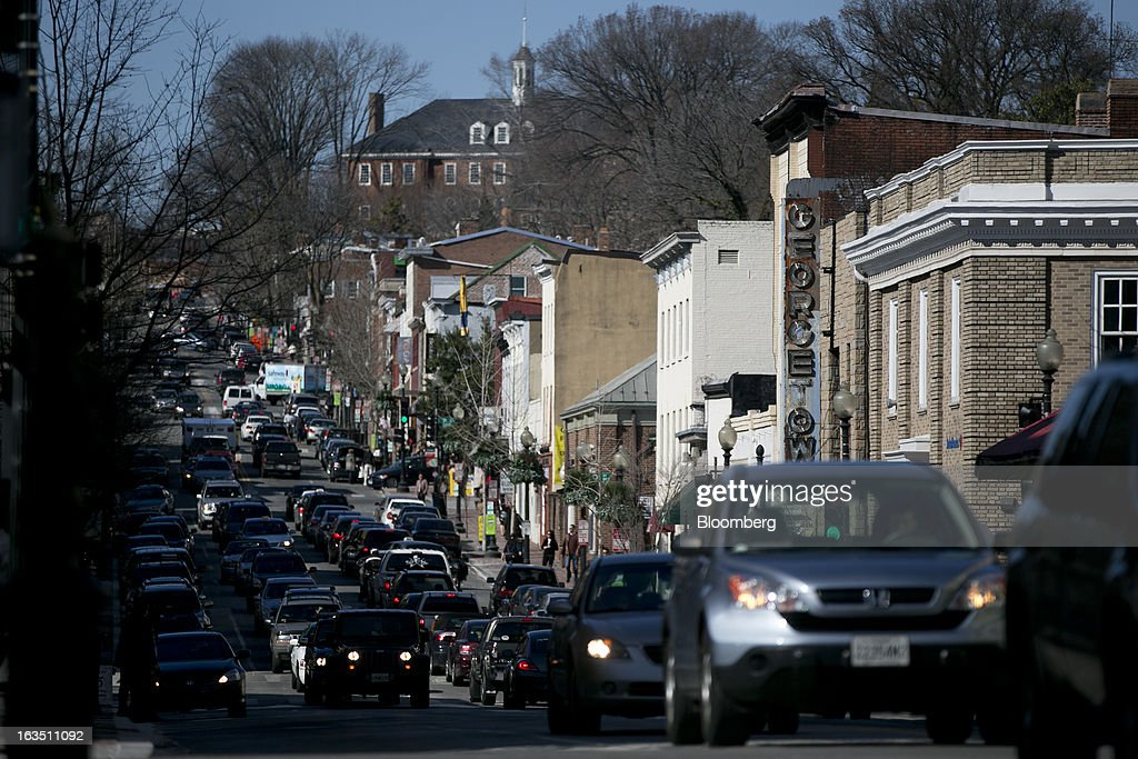 Vehicles drive on Wisconsin Ave. in the Georgetown neighborhood of Washington, D.C., U.S., on Saturday, March 9, 2013. The U.S. Census Bureau is expected to release advance retail sales data for February on March 13. Photographer: Andrew Harrer/Bloomberg via Getty Images