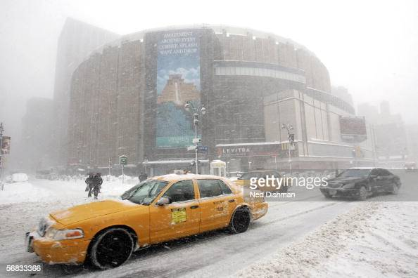 Vehicles drive past Madison Square Garden during a snow storm prior to a game between St John's University and Syracuse University on February 12...