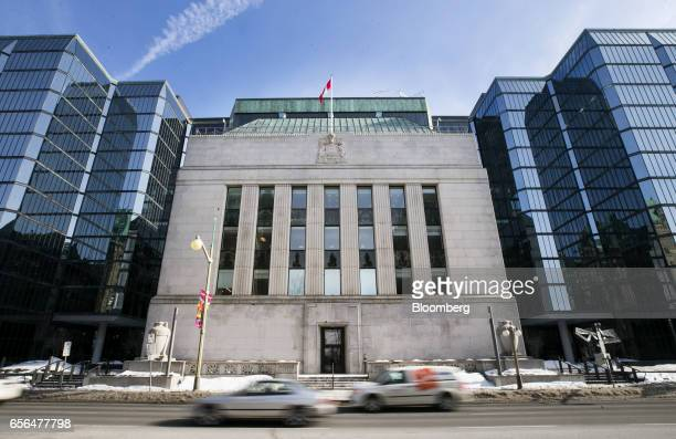 Vehicles drive past the Bank of Canada offices in Ottawa Ontario Canada on Monday March 20 2017 Trudeau's finance chief Bill Morneau will release his...