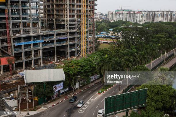 Vehicles drive past the construction site for the Kantharyar Center a mixeduse development that will also that will also house the Wyndham Grand...