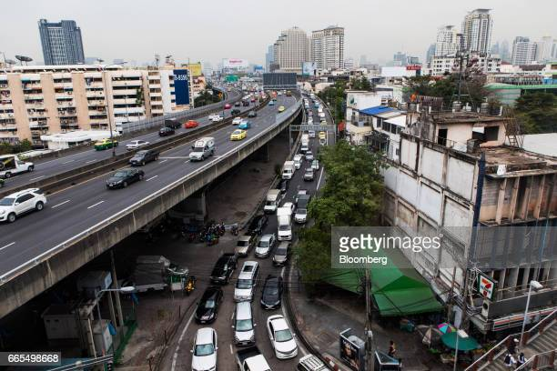 Vehicles exit a highway in the Phaya Thai District of Bangkok Thailand on Wednesday April 5 2017 The central bank predicts growth will accelerate to...