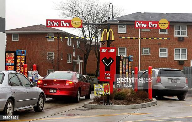 Vehicles in two separate driveup lanes place orders at a McDonald's drivethru location January 17 2006 in Rosemont Illinois McDonald's reportedly in...