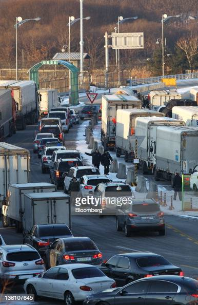 Vehicles leave for North Korea at the Inter Korean Transit Office near the Demilitarized Zone in Paju South Korea on Monday Dec 26 2011 North Korea...