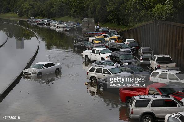 Vehicles left stranded on a flooded Interstate 45 in Houston Texas on May 26 2015 Heavy rains throught Texas put the city of Houston under massive...