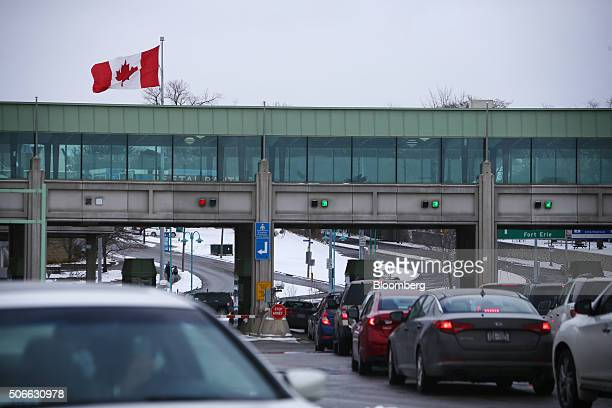 Vehicles make their way through the Canadian border crossing in Niagara Falls Ontario Canada on Jan 23 2016 A 34 percent plunge in the Canadian...