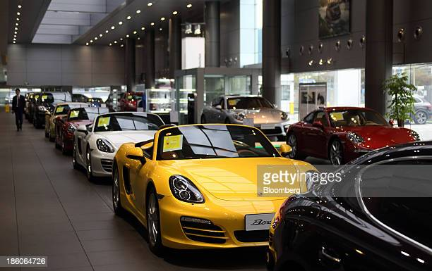 Vehicles manufactured by Porsche AG including a Boxster front stand on display at the Porsche Centre Shanghai Minhang showroom in Shanghai China on...