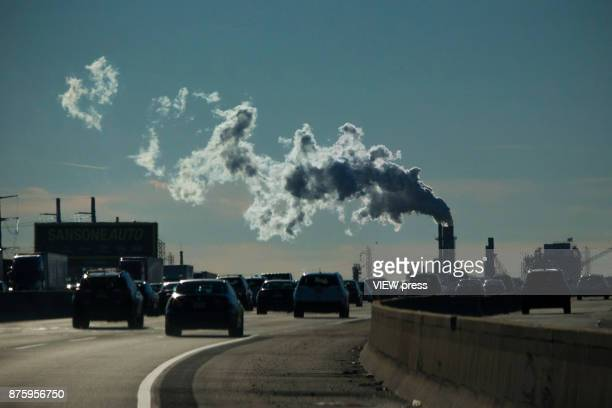Vehicles move along the The New Jersey Turnpike Way while a Factory emits smoke on November 17 2017 in Carteret New Jersey The United States is still...