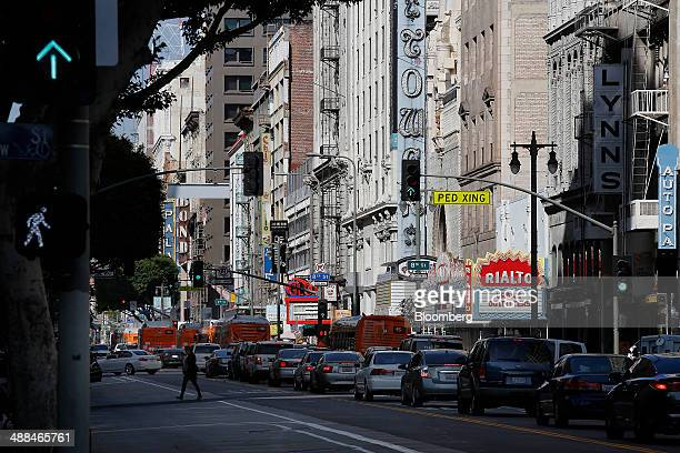 Vehicles move down Broadway Boulevard in downtown Los Angeles California US on Wednesday April 16 2014 The rehab of warehouses and factories in the...