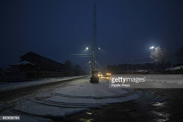 Vehicles move early morning after the fresh snowfall in Srinagar the summer capital of Indian controlled Kashmir on January 25 2017Normal life in...