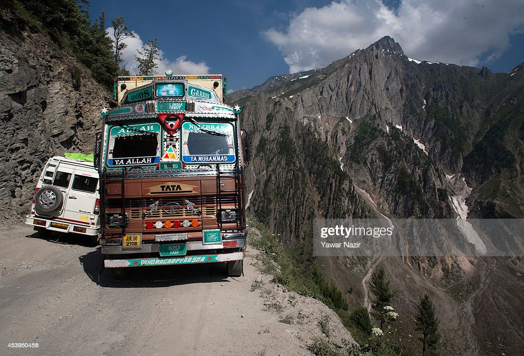 Vehicles move on a treacherous pass on August 22, 2014 in Zojila, about 108 km (67 miles) east of Zojila, has an impressive location, enclosed by Kashmir valley on one side and Drass valley on the other side and functions as a major link between Ladakh and Kashmir, is considered to be the World's most dangerous pass is located at 3529 meters. The average snow buildup on the rocky Zojila- which is part of the 443 km (275 miles) long Srinagar-Leh highway- normally stays in the level of 15 to 25 meters and is closed for half year. It opens up in late spring and witnesses violent breezes because of the conical shape. Travellers on the pass have to face and withstand snowstorms, fierce air currents, cold and highly dangerous circumstances.