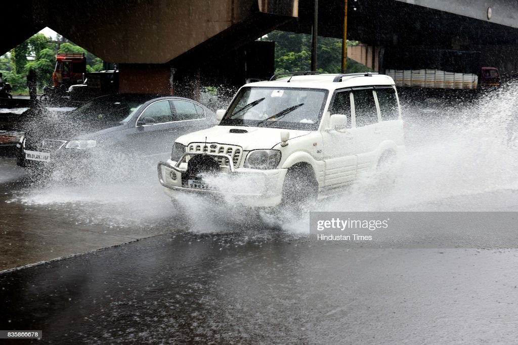 Vehicles moving during the rain, on August 19, 2017 in Mumbai, India. These weather conditions have been attributed to the presence of a low pressure which is currently lying over the Vidarbha region. Due to this, moisture incursion has increased over Mumbai as well as Thane and the cities have recorded these heavy spells.