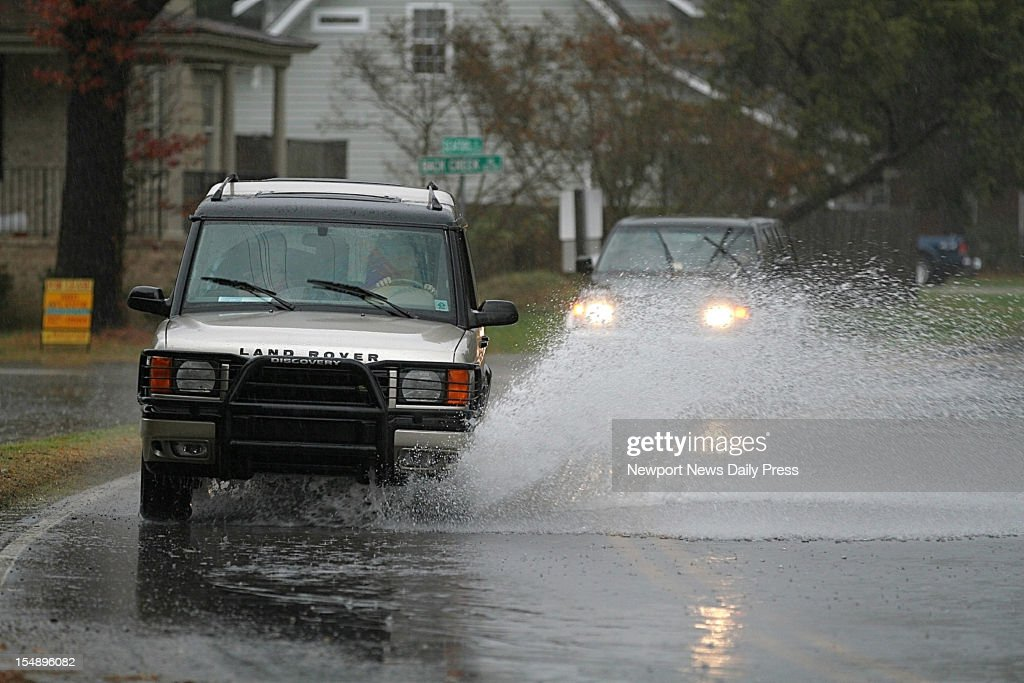 Vehicles navigate high water on due to Hurricane Sandy, on Seaford Road in York County, Virginia, Sunday, October 28, 2012.