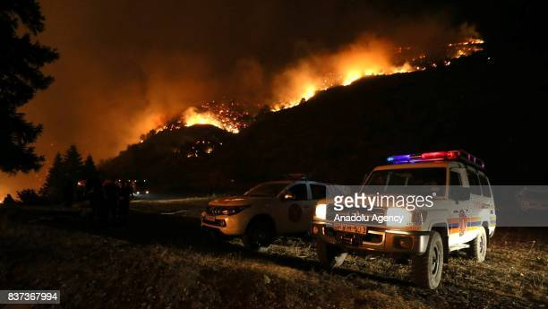 Vehicles of fire department are seen at the site of wildfire in Daba and Tsagveri villages of Tbilisi's Borjomi Valley Georgia on August 22 2017...
