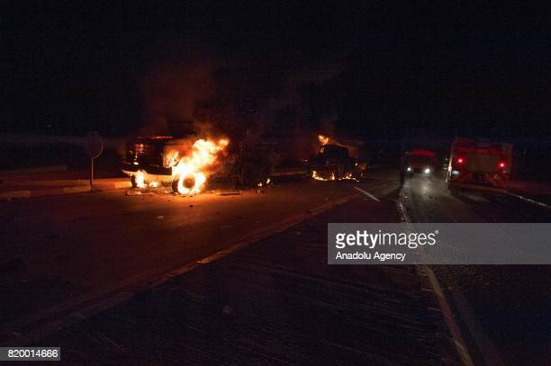 Vehicles of Kingdom of Morocco's Gendarmerie are on fire in Al Hoceima Morocco on July 21 2017 Protesters continues to stage demonstrations for over...