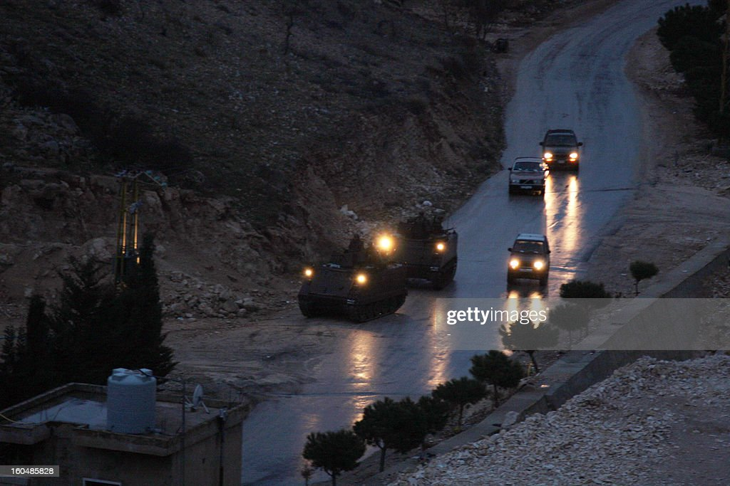 Vehicles of the Lebanese army drive near the village of Arsal, near the border with Syria, where a clash between gunmen and the army happened killing two soldiers on February 1, 2013. 'An army patrol was ambushed in Arsal as it hunted a man wanted for several terrorist acts,' the army said in a statement adding that 'an army captain and soldier were killed while several others were wounded in the clash'. AFP PHOTO STR