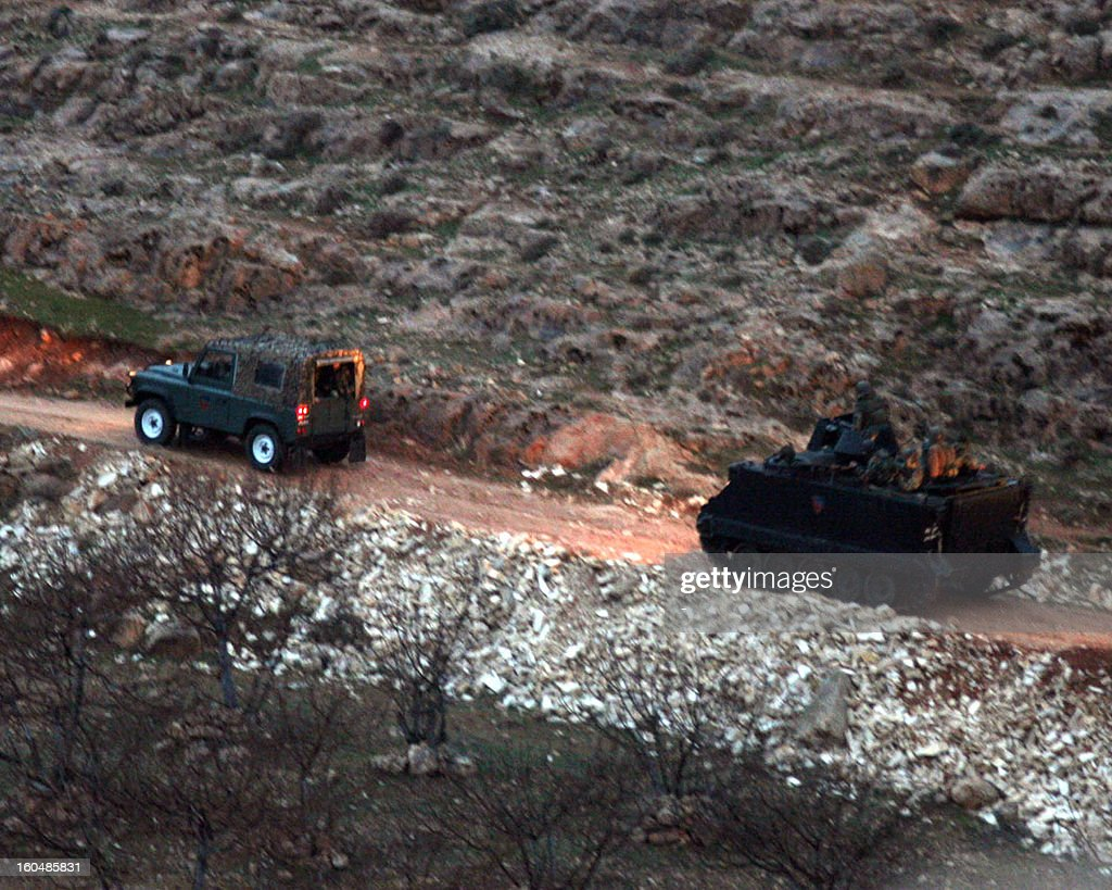 Vehicles of the Lebanese army drive near the village of Arsal, near the border with Syria, where a clash between gunmen and the army happened killing two soldiers on February 1, 2013. 'An army patrol was ambushed in Arsal as it hunted a man wanted for several terrorist acts,' the army said in a statement adding that 'an army captain and soldier were killed while several others were wounded in the clash'.