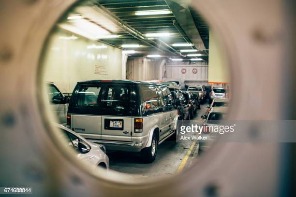 Vehicles on a ferry looking through porthole
