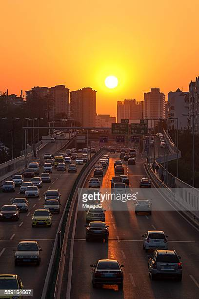 Vehicles on Highway During Sunset