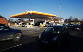 Vehicles pass a Royal Dutch Shell petrol station in Hook near Basingstoke on January 20 2016 Royal Dutch Shell said it expected a sharp decline in...