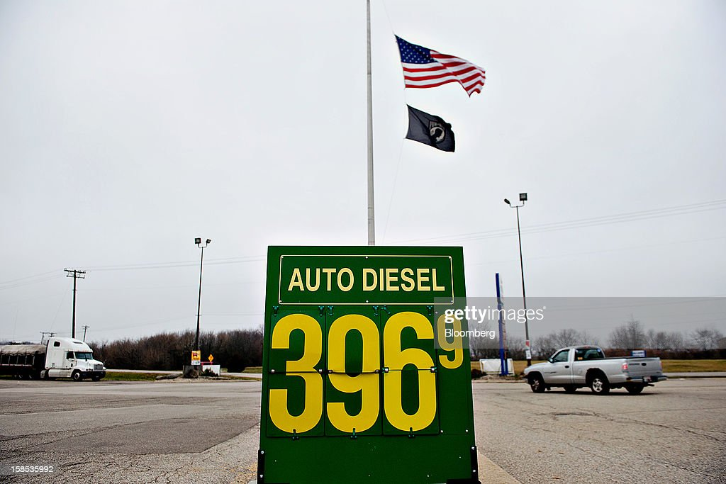 Vehicles pass a sign advertising the price of diesel fuel at a gas station in Princeton, Illinois, U.S., on Tuesday, Dec. 18, 2012. Retail gasoline in the U.S. fell to the lowest level in a year as refineries restored production and stockpiles rose to an eight-month high, blunting criticism of President Barack Obama's energy policies. Photographer: Daniel Acker/Bloomberg via Getty Images