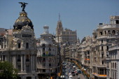 Vehicles pass along Gran Via as Spanish flags hang from lamposts the day before Prince Felipe's coronation on June 18 2014 in Madrid Spain Prince...