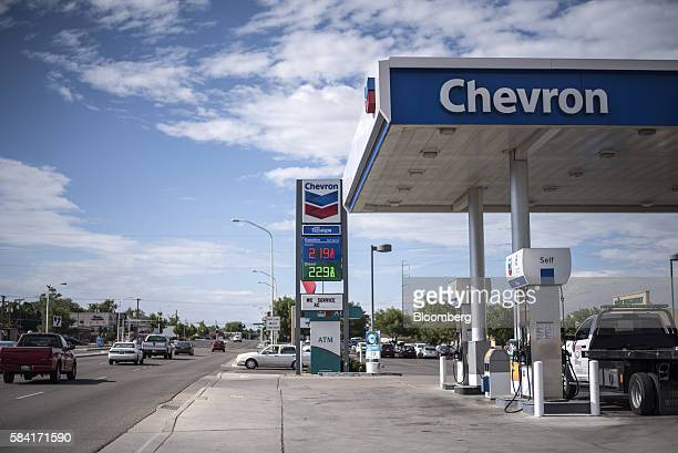 Vehicles pass outside a Chevron Corp gas station in Albuquerque New Mexico US on Tuesday July 26 2016 Chevron is scheduled to release earnings...