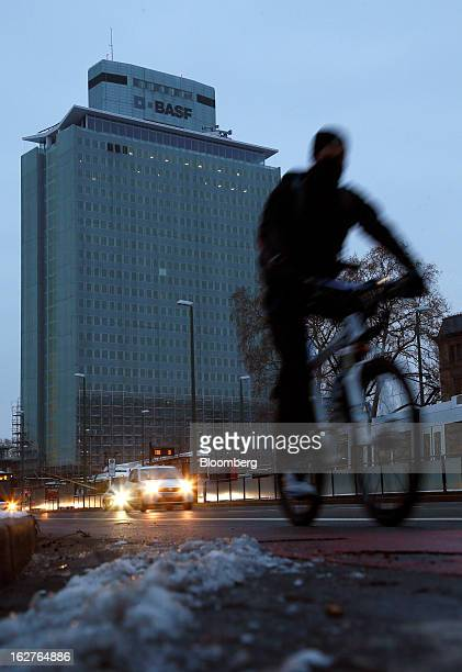Vehicles pass the headquarters of BASF SE in Ludwigshafen Germany on Tuesday Feb 26 2013 BASF SE forecast growth in earnings and sales this year...