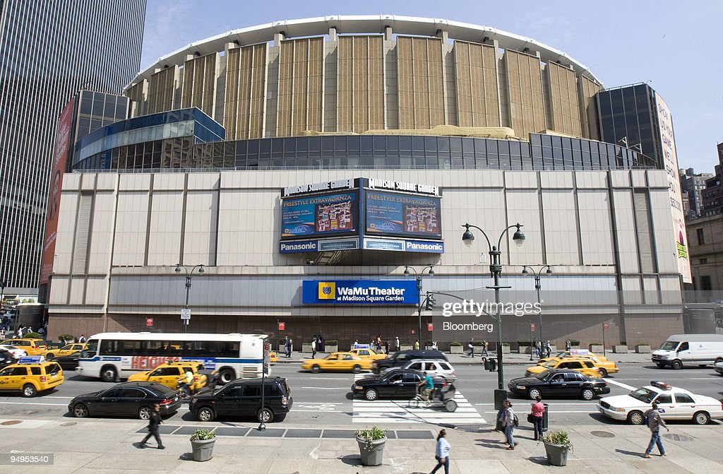 Vehicles pass the Madison Square Garden arena in New York US on Friday May 8 2009 Cablevision Systems Corp the media company controlled by the Dolan...