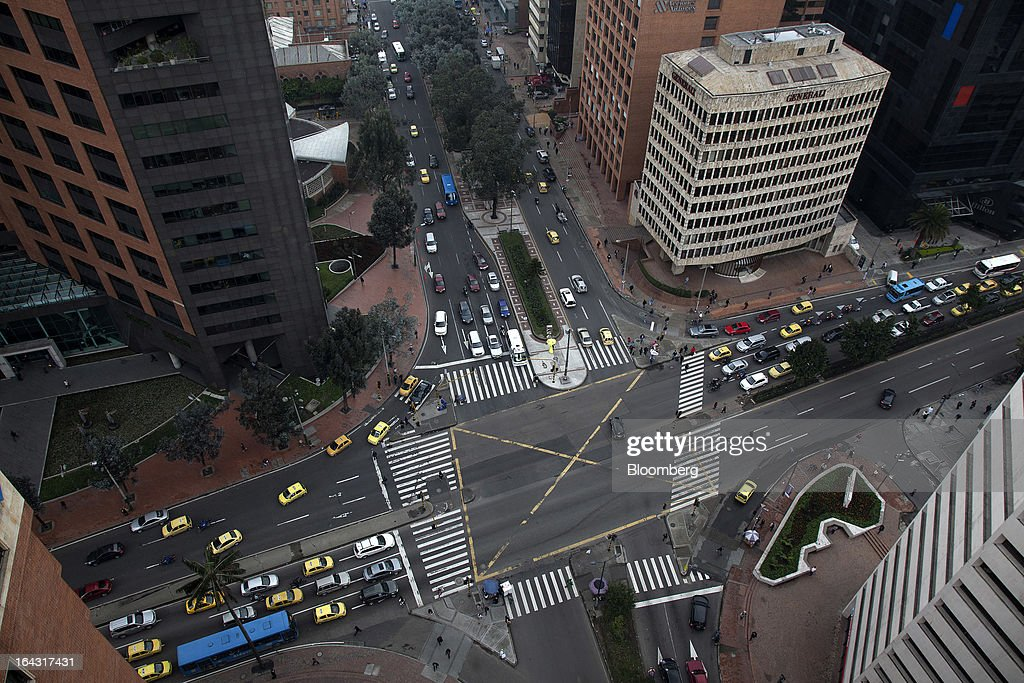 Vehicles pass through an intersection in the financial district of Bogota, Colombia, on Friday, March 22, 2013. Central bank policy makers will lower borrowing costs by 25 basis points to 3.5 percent on March 22, according to 29 of 32 analysts and economists surveyed by Bloomberg. Photographer: Jose Cendon/Bloomberg via Getty Images