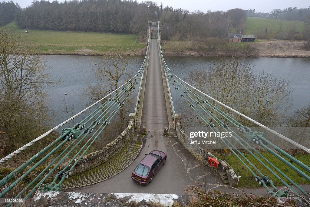 A vehicles passes across the Union Bridge on the River Tweed on March 6, 2013 in Berwick Upon Tweed, England. The bridge was built in 1820 and is Europe's oldest surviving iron chain suspension bridge. The bridge which connects the Scottish village of Fishwick to Horncliffe on the English bank is now facing closure with both Scottish Borders Council and Northumberland, citing a £4.7million repair bill for the structure.