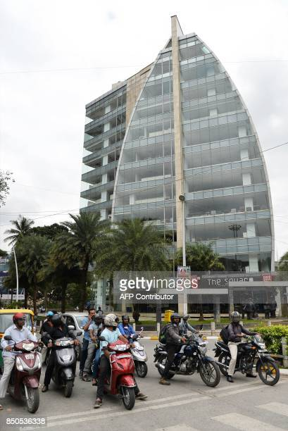 Vehicles ply in front of Cafe Coffee Day Square outlet situated in the Cafe Coffee Day Head Office building which was raided by the Income Tax...