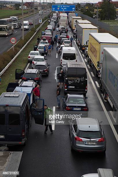 Vehicles queue to cross the border from Hungary into Austria on September 5 2015 near Nickelsdorf Austria Last night the Hungarian government ordered...