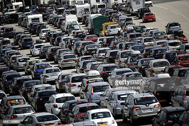 Vehicles queue up at the 'Peage de Roussillon' highway toll on the A7 motorway on July 2011 near Vienne southeastern France 400 kmlongtraffic jams...