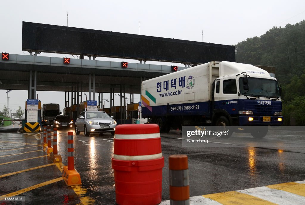 Vehicles returning from the Gaeseong Industrial Complex pass a gate at the Customs, Immigration and Quarantine (CIQ) office near the demilitarized zone (DMZ) in Paju, South Korea, on Friday, July 12, 2013. North Korea notified South Korea today that it has deferred two separate sets of talks on the tours and the family reunions it proposed yesterday, and said it wants to focus on the ongoing dialog to reopen the joint Gaeseong industrial zone, the Souths Unification Ministry said in an e-mailed statement. The two sides yesterday decided to hold talks in Gaeseong on July 15, which will be their third round in one week, on normalizing operations in Gaeseong after the North unilaterally recalled its workers in April. Photographer: SeongJoon Cho/Bloomberg via Getty Images