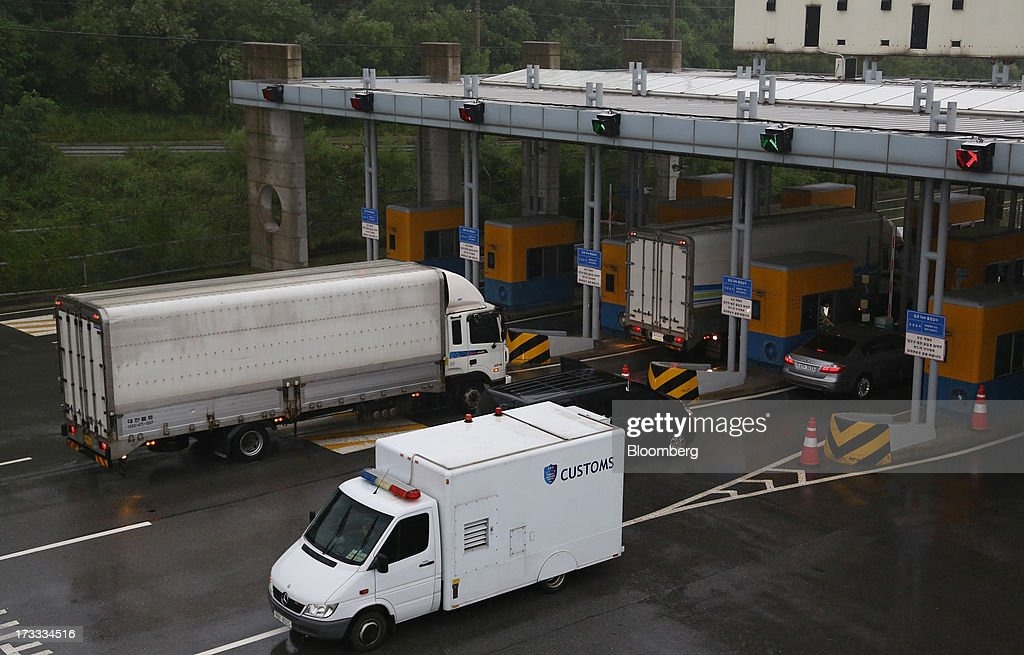 Vehicles returning from the Gaeseong Industrial Complex pass through a gate at the Customs, Immigration and Quarantine (CIQ) office near the demilitarized zone (DMZ) in Paju, South Korea, on Friday, July 12, 2013. North Korea notified South Korea today that it has deferred two separate sets of talks on the tours and the family reunions it proposed yesterday, and said it wants to focus on the ongoing dialog to reopen the joint Gaeseong industrial zone, the Souths Unification Ministry said in an e-mailed statement. The two sides yesterday decided to hold talks in Gaeseong on July 15, which will be their third round in one week, on normalizing operations in Gaeseong after the North unilaterally recalled its workers in April. Photographer: SeongJoon Cho/Bloomberg via Getty Images