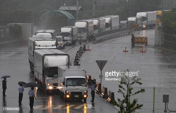 Vehicles returning from the Gaeseong Industrial Complex wait in line on a road linked to North Korea towards the Customs Immigration and Quarantine...