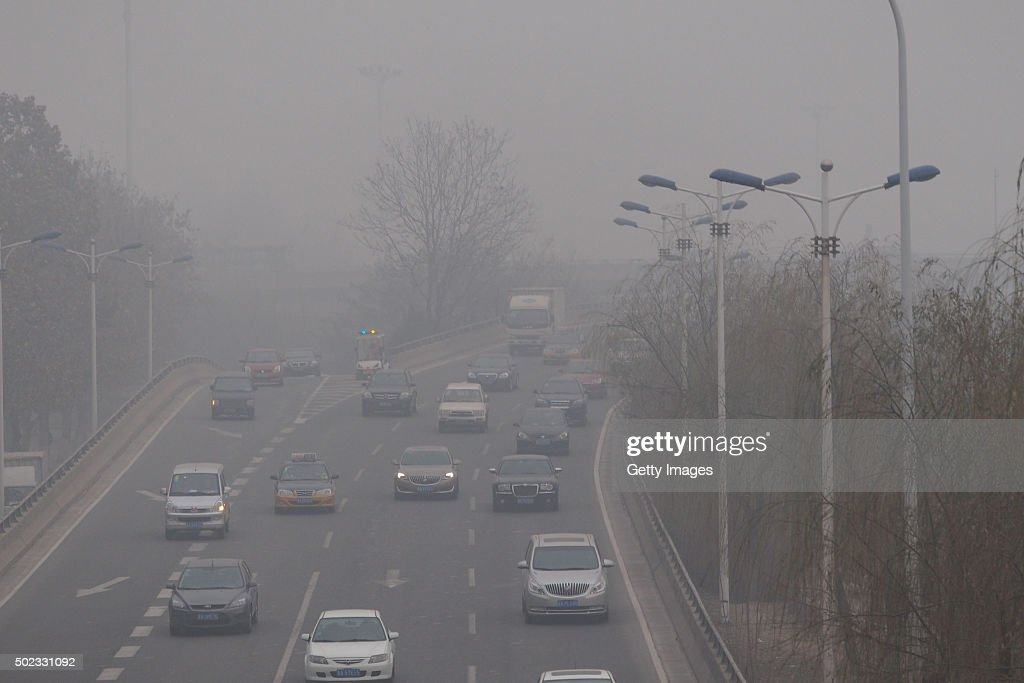 Vehicles run in the heavy smog on December 22 2015 in Shijiazhuang Hebei Province of China Hebei issued its firstever air pollution red alerts the...
