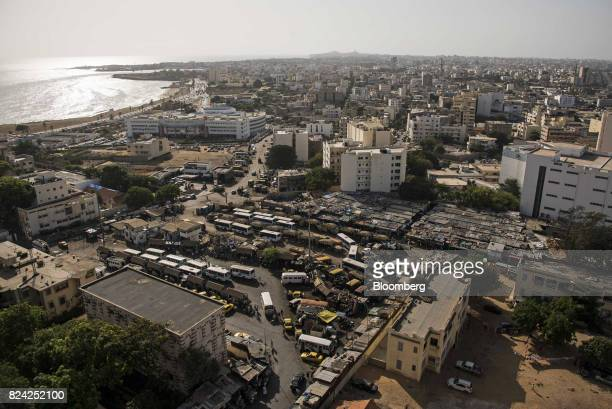 Vehicles sit at a parking lot in the Plateau district of Dakar Senegal on Friday July 28 2017 Senegalese voters will elect a new parliament on Sunday...