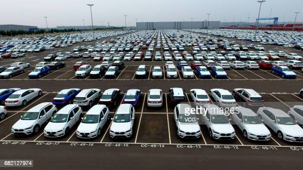 Vehicles sit in a parking lot at BMW Brilliance Automotive Tiexi Plant on May 11 2017 in Shenyang China The plant was approved as national 4A level...